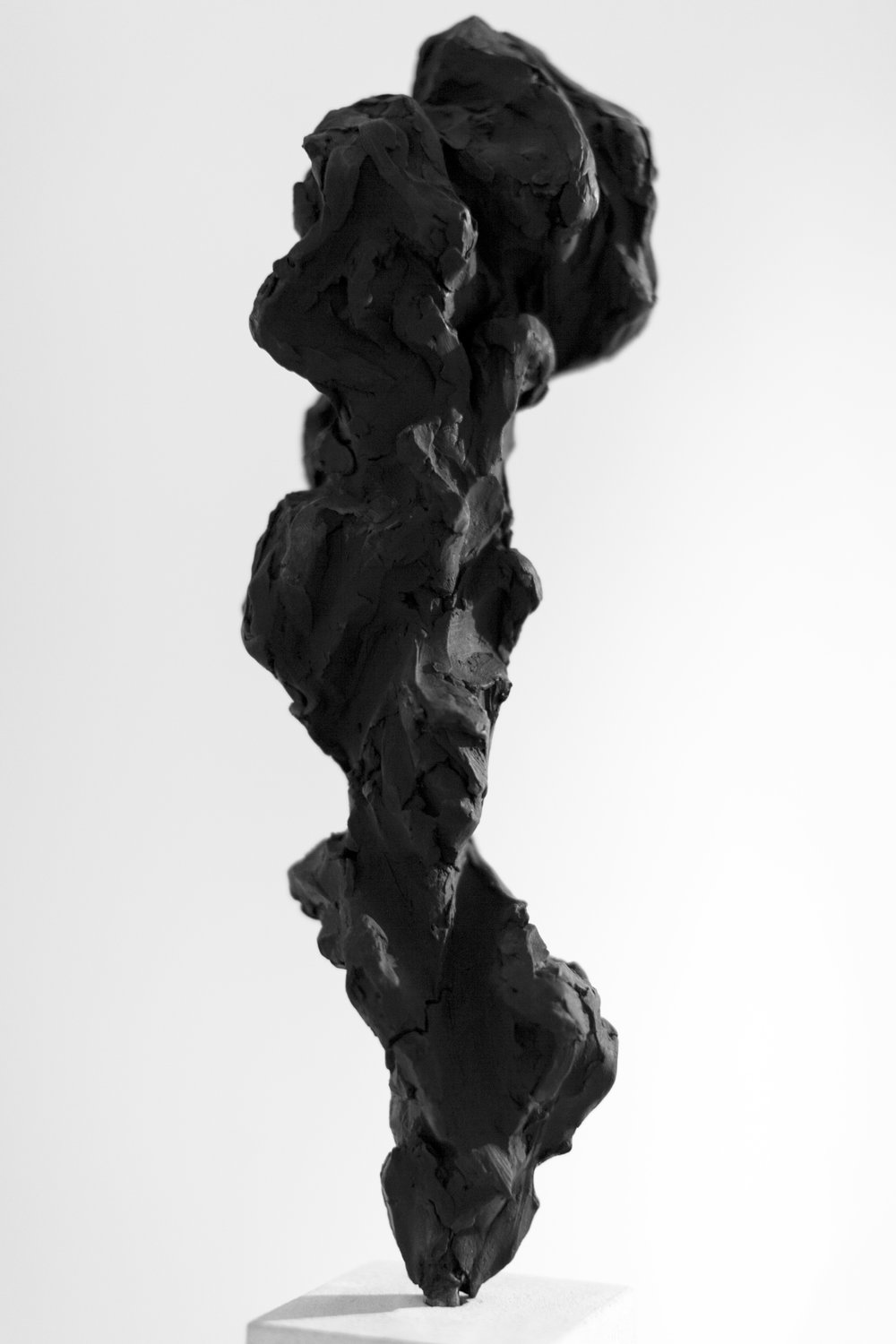 Black Totem No.1,  2017   Painted bronze and portland stone, 50x10x10 cm