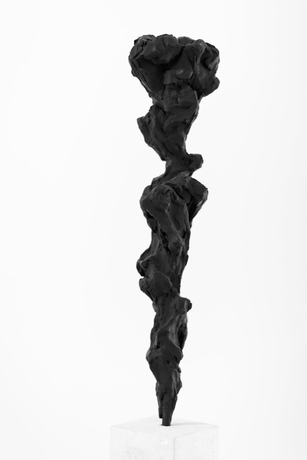 loud Totem no.2,  2014    Charcoal powder, resin and steel, 300 x 60 x 60 cm