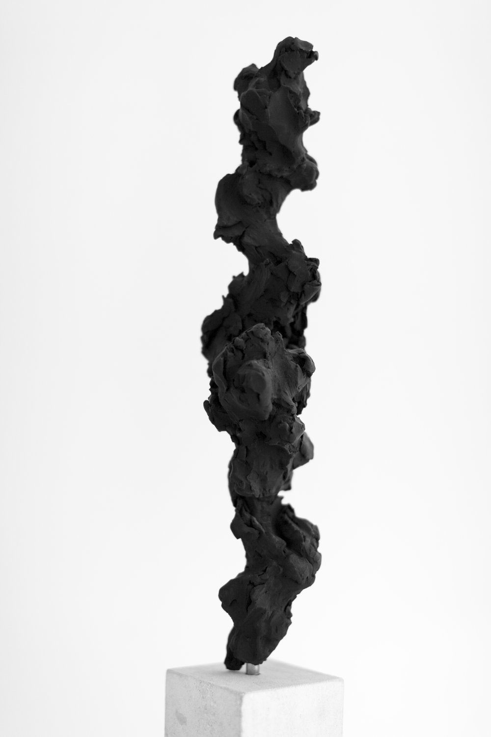 Black Totem No.3,  2017   Painted bronze and portland stone, 50x10x10 cm