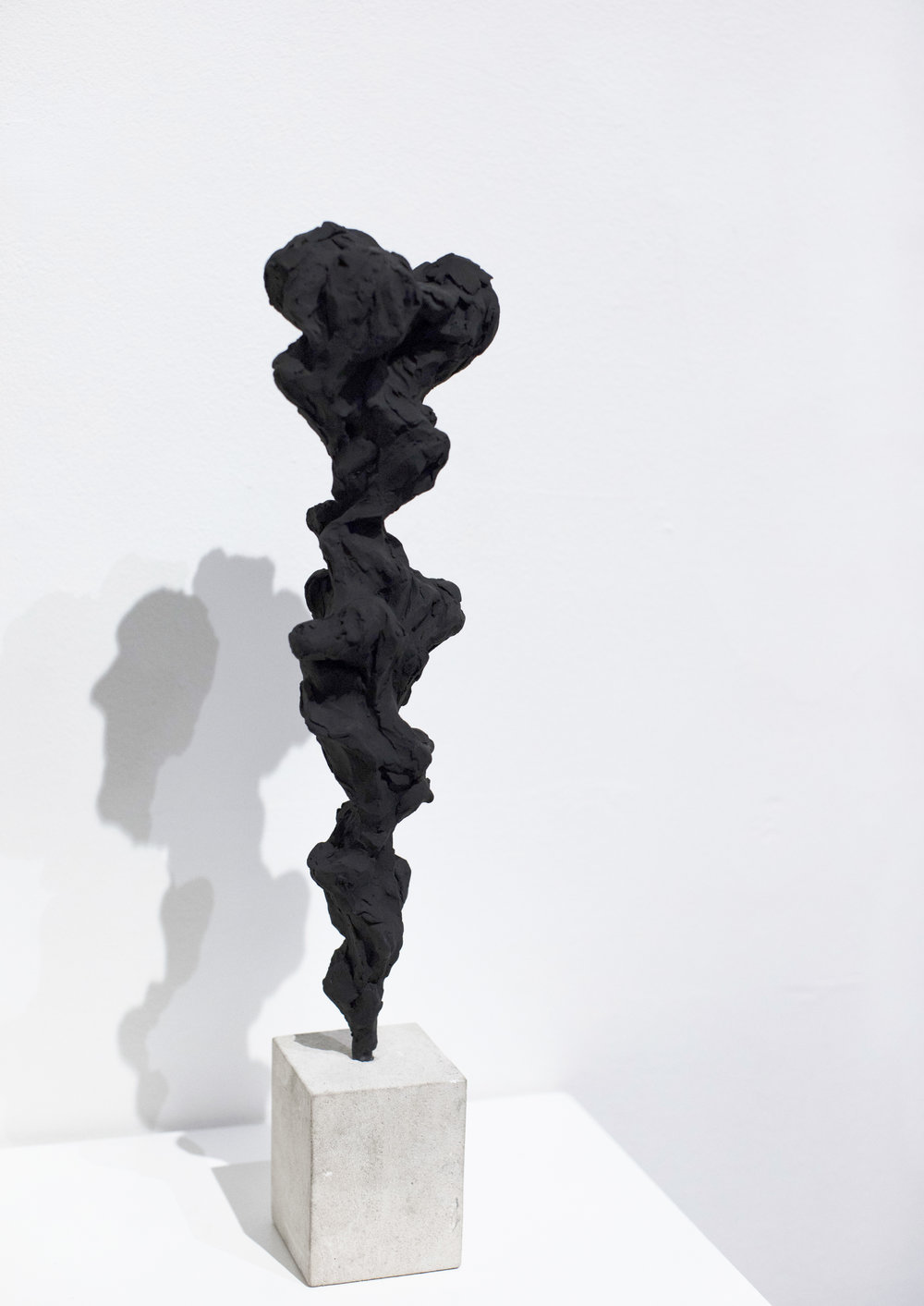 Black Totem No.5, 2017  Painted bronze and portland stone, 50x10x10 cm