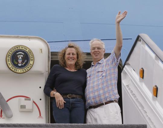 """In this Monday, Sept. 18, 2017 photo Christopher Jenkins waves while he stands with Julia Mord as they mimic a presidential arrival for a friend who is making their picture during their tour of the """"Air Force One Experience,"""" a full-sized 747 replica of Air Force One which is now open to the public in North Kingstown, R.I. (AP Photo/Stephan Savoia)  Stephan Savoia"""