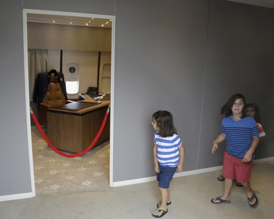 """In this Monday, Sept. 18, 2017 photo Camden Palmisciano-Wright, 4, left, and Riley Palmisciano-Wright, 6, approach the president's office on board the """"Air Force One Experience,"""" a full-sized 747 replica of Air Force One which is now open to the public in North Kingstown, R.I. (AP Photo/Stephan Savoia)"""