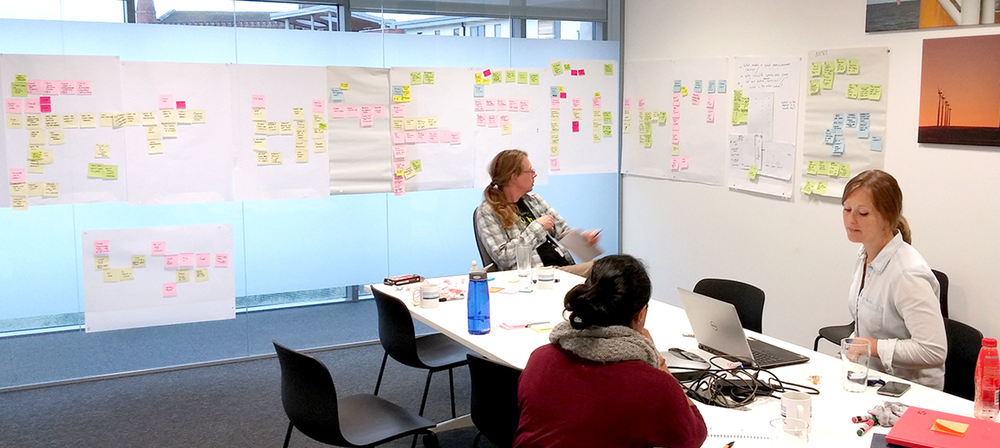 User story mapping workshop, with product owner, UX team and developers present