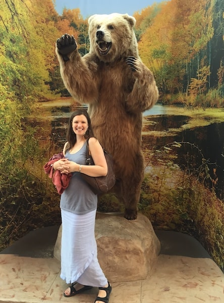 Gabrielle Usatynski in front of bear display.