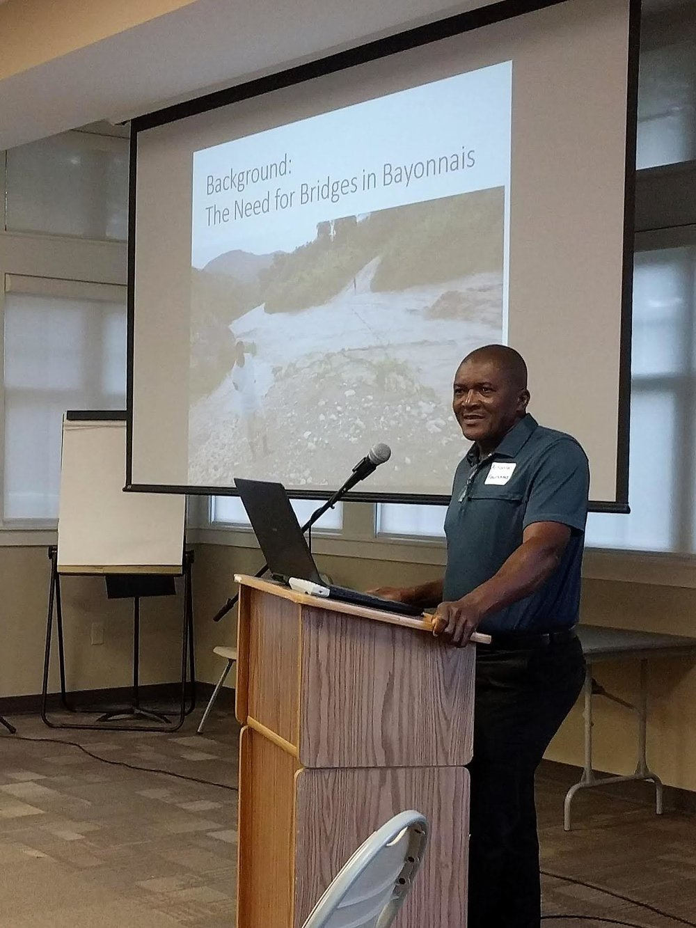 Pastor Actionnel Fleurisma, director of OFCB Ministries, talks about the need for the proposed bridges project in the Bayonnais Valley of Haiti.