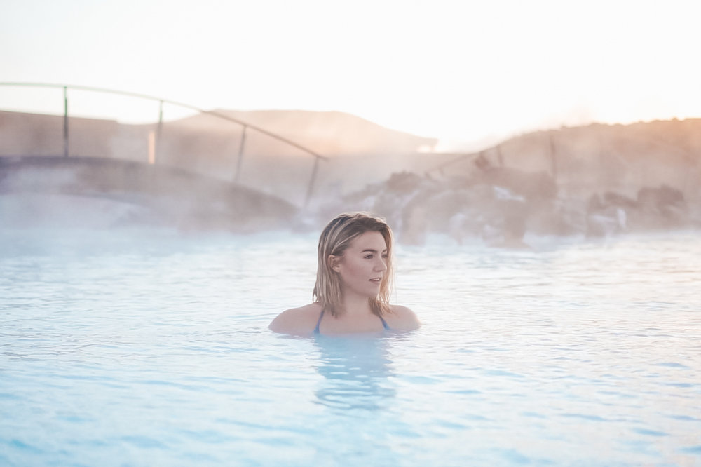 Sitting in the Blue Lagoon of Iceland at sunrise.