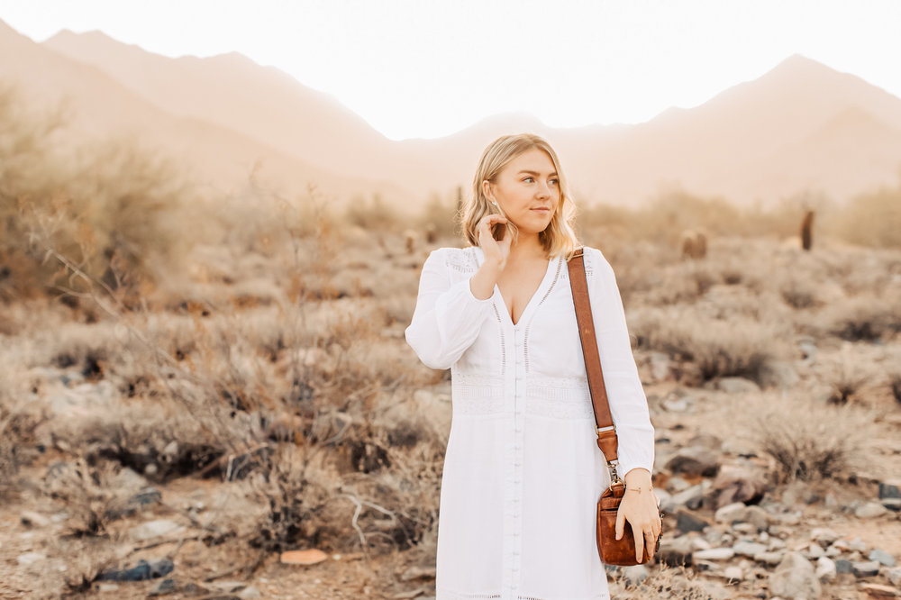 Wearing a white dress in the desert at sunrise.