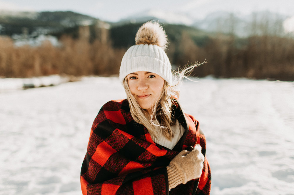 Bundled up in a blanket in the winter snow in Whistler, BC