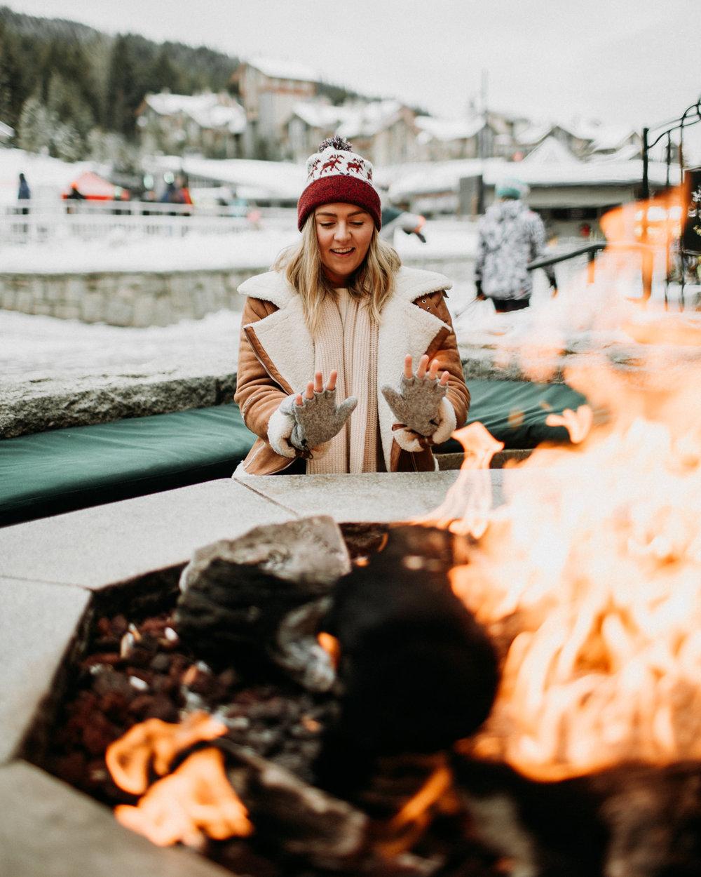 Sitting around a fire in Whistler Village