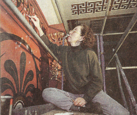 JoAnn May of Wiebold restoration applies a plaster compound to a cathedral wall.