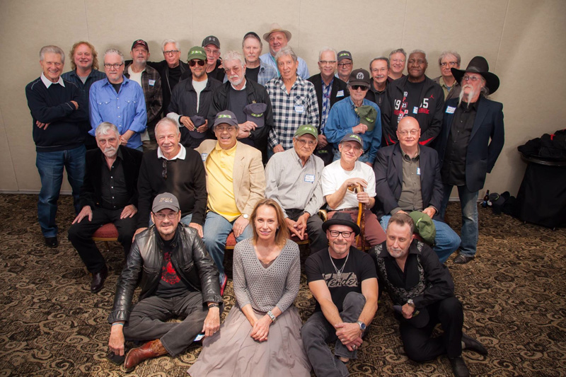 Cale's friends and associates gathered at a pre-induction reception on October 31, 2014 (photo credit: Cliff Moore)  (Standing L to R) Johnny Williams, Steve Ripley, James Cruce, Tommy Tripplehorn, Jamie Oldaker, Jim Keltner, Gary Gilmore, Karl Himmel, Don Preston, Bill Kenner, Elvin Bishop, Charles Tuberville, Doug Belli, Jim Karstein, Steve Hickerson, Shelby Eicher, Ray D. Rowe, Walt Richmond, Skip VanWinkl  (Seated Middle Row) Rocky Frisco, David Teegarden Sr., Larry Bell, Jimmy Markham, Jimmy Gordon, Jim Byfield  (Seated Front) Don White, Christine Lakeland Cale, Nick Rather, Jamie Nichol  Not pictured: Chuck Blackwell, Tommy Crook, Casey VanBeek