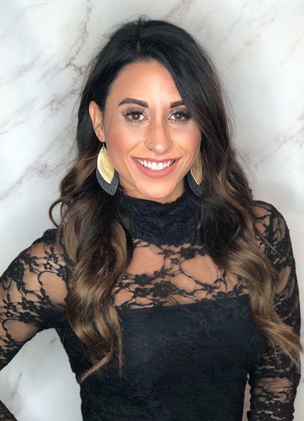 Lauren believes you should wear your hair like a crown! Specializing in keratin treatments and fresh cuts, she also loves using balayage and dimension adding techniques to boost dark hair, as well as fun bright pieces to maximize blondes. She'll create that crown with a fun updo or playful curls.