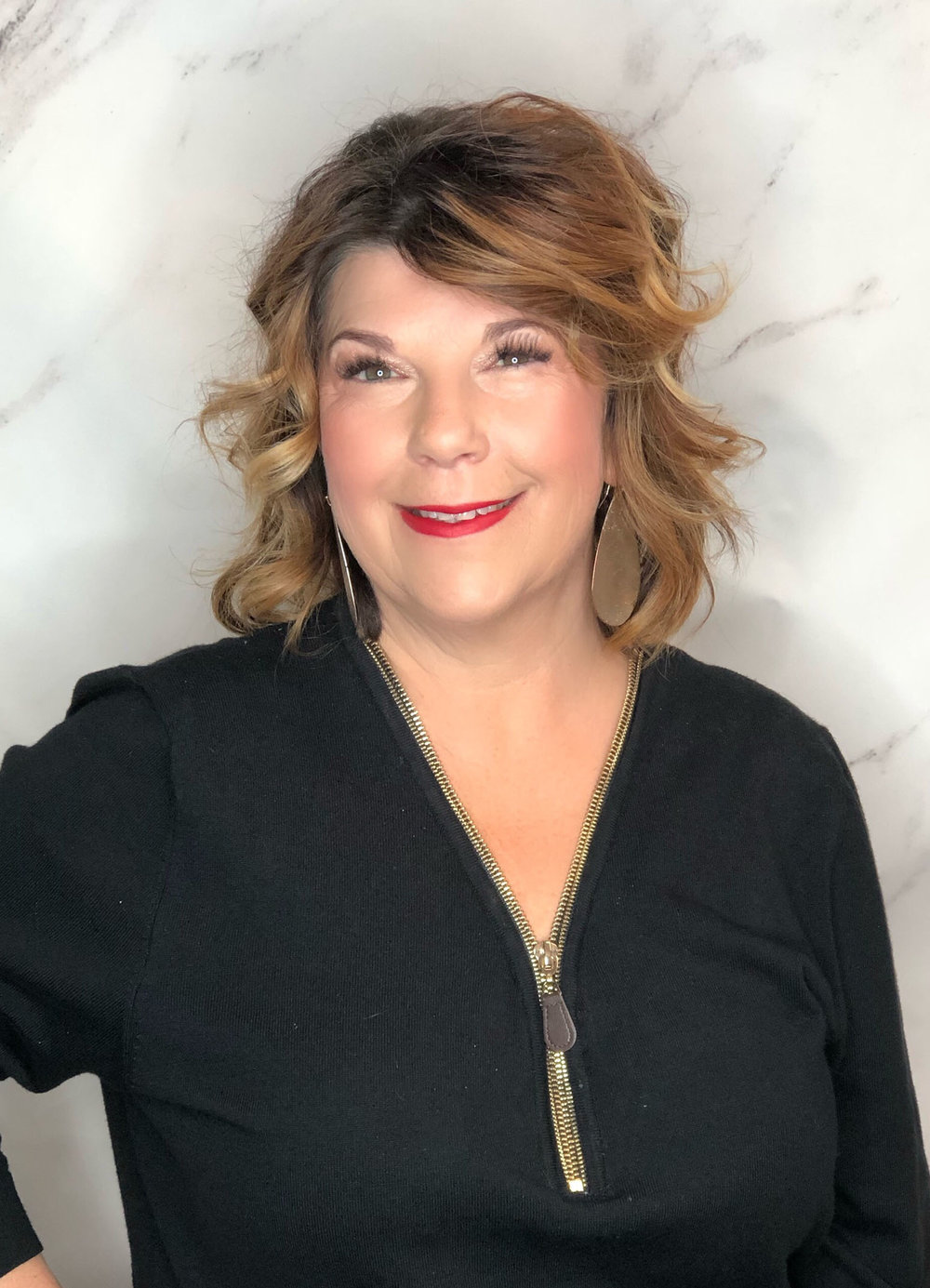 Jenny is the salon manager at Fringe. Customer service is her middle name. She will greet you with a friendly smile and help you with any hair care needs. Come in for a tour and she will have a fresh cup of coffee brewing.