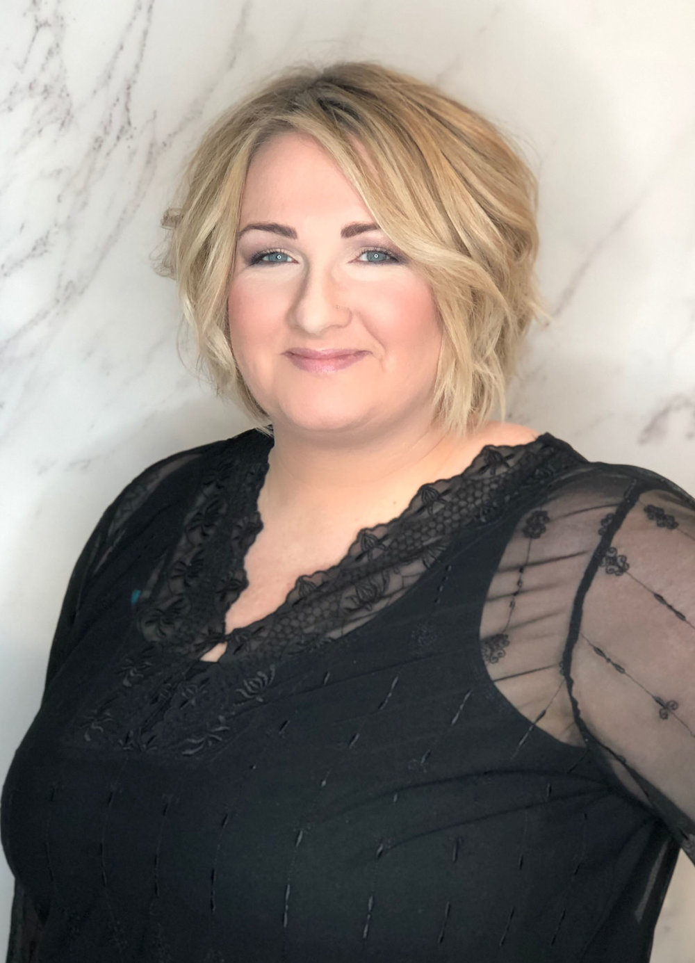 """Heather loves working in an industry that promotes self esteem, beauty and creativity. She's experienced to transform hair into a work of art, while maintaining functional and easy to manage styles. She's never known a client that doesn't become a friend and looks forward to meeting you to discuss how to feel your best and conquer your hair """"fears."""""""