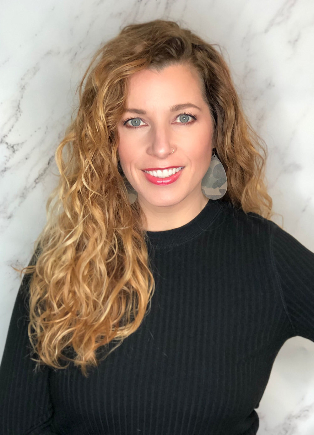 """Michelle strives to make you look and feel your best. She loves to use dimensional color and on-trend styling techniques to bring out the best version of """"YOU"""". Let her transform your look and bring out your true inner beauty."""