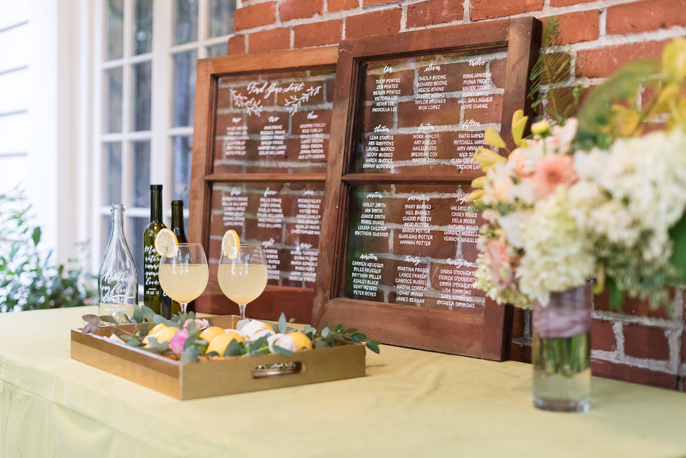Whimsical Garden Wedding Barn Window Seating Chart by Caitlin O'Bryant Design. Photo by Tina Ricketts Photography. Host: Styled Shoots Across America