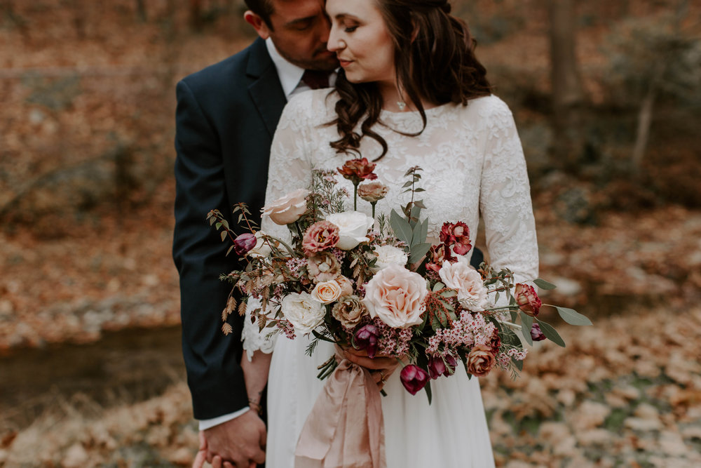 Soft and Moody Outdoor Fall Wedding. Stationery and Calligraphy by Caitlin O'Bryant Design. Photography by Jieru Photography. Venue: Farm and Garden Flowers. Concept & Styling: Lily Muir. Wedding Dress: Hyacinth Bridal. Bridesmaids Dresses: Bella Bridal. Florals: Courtney of Winsome Floral. Rentals: Lilac & Lace Co. and Caroline Rentals & More. Desserts: Amy's Sweet Bakery. Stylist: Susan Padron. MUA: Makeup by Shanna Gabrielle. Hair: Dara H Hair Stylist. Ribbons & Linens: Thistle and Twill. Jewelry & Fur Coat: Malena's Vintage Boutique.