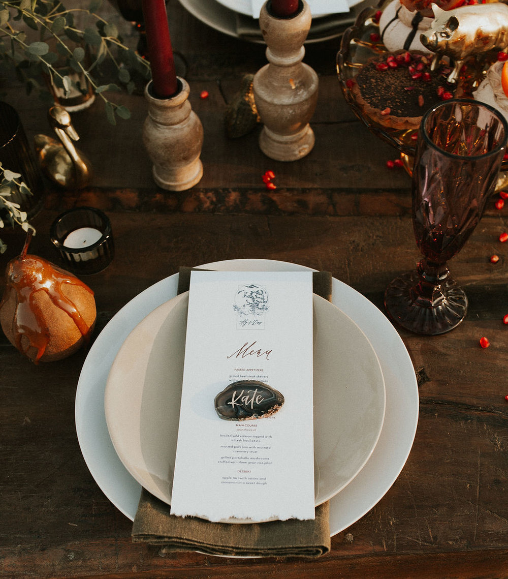 Rustic and earthy harvest moon central Oregon wedding vow renewal. Menus and agate place card calligraphy by Caitlin O'Bryant Design. Photography: Michelle Breiter Photography. Planning + Coordination: A Little Grace A Little Lace. Venue: Wine Down Ranch. Desserts: The Crumb Cakery. Jewelry: Saressa Designs. Rentals: Curated Event Rentals. Gown: The Bespoke Bride. Officiant: Chris Lewis. Bride + Groom: Kirstyn and Adam Beyer. Florals: Le Petit Flower Shop. MUAH: Tiffany Randolph. Assistant Coordination: Firefly Events
