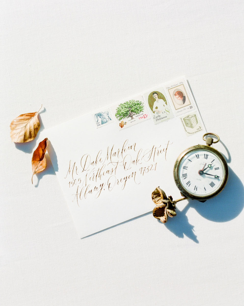 Timeless heirloom wedding inspiration. Calligraphy wedding addressing and vintage postage by Caitlin O'Bryant Design. Photography by Mylyn Wood Photography. Paper Goods by Caitlin O'Bryant Design. Florals: Caroline Reusen Flowers. Models: Jens Behind the Lens. HAMU: Coreene Collins Hair. Styling Assistant: Jessica Staley.