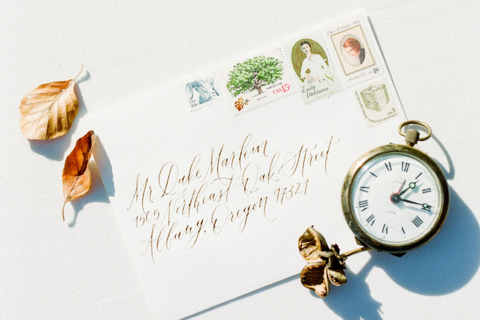 Fine Art Calligraphy Addressing by Caitlin O'Bryant Design. Photo by Mylyn Wood Photography. Wedding invitations and stationery with vintage postage. Light and airy weddings.