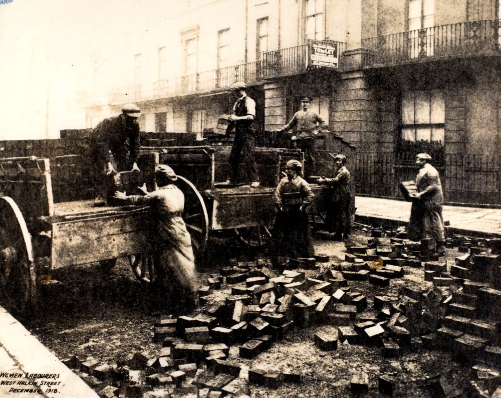 Women were employed in hard manual labour as well, seen here repaving streets in Pimlico.