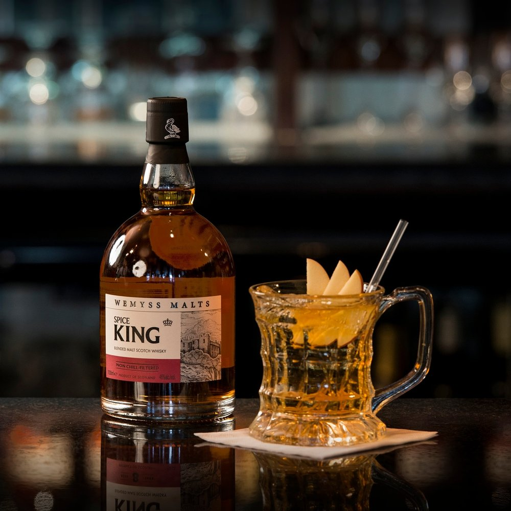SPICE ON ICE - Ingredients:50 ml Wemyss Malts Spice King100ml Normandy Cider50ml FevertreeGinger AleMethod: In the glass build over broken block ice and stir with a swizzleGlass: Half-pint Beer TankardGarnish: Caramelised apple crisp and strawAdditionally we recommend The Hive as a Tailor-made Old Fashioned