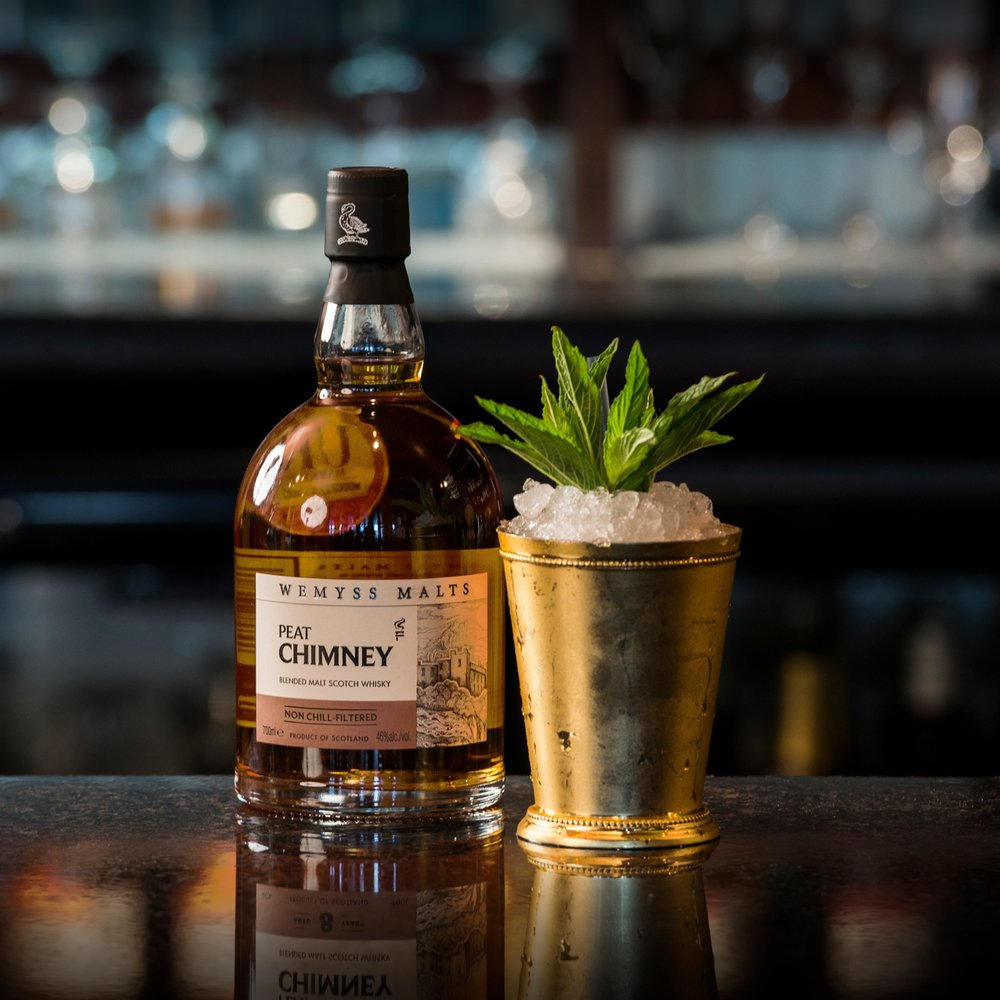 Peat Smash - Ingredients:50ml Wemyss Malts Peat Chimney14 mint leaves2 bar spoons Demerara sugarSpritz Fernet BrancaMethod: Spray the inside of cup with Fernet Branca. Separately, with all ingredients and cubed ice in a mixing glass, stir until the flavours and aromas of the mint have infused into the liquid. Single strain over cracked ice in cupGlass: Julep CupGarnish: 3 or 4 mint sprigs. Sprinkle with flamed cinnamonAdditionally we recommend The Hive as a Tailor-made Old Fashioned