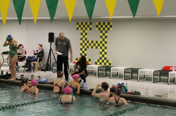 Swimmers hearing some final thoughts from the coaches before beginning the hour-long swim. Photo by Adaline Bisese