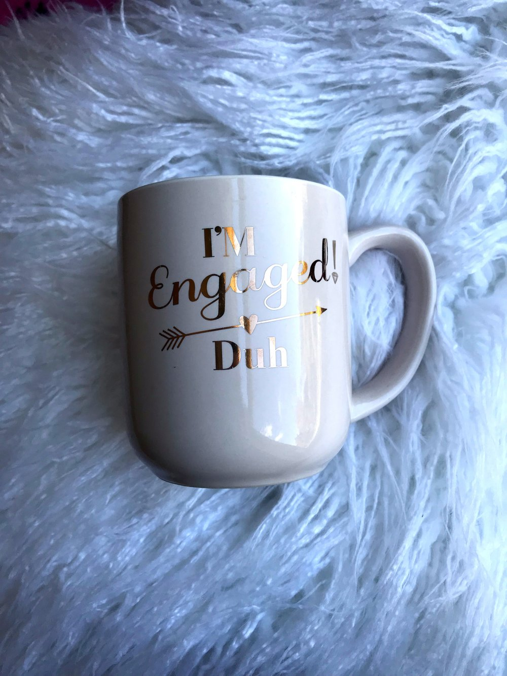 An Engagement Mug - Let's face it, once you get engaged you want everyone to know :) This mug just made me happier, I would drink some tea during planning and then get distracted by my new shiny ring. I got mine from TJ Maxx, but lots of stores carry them now.