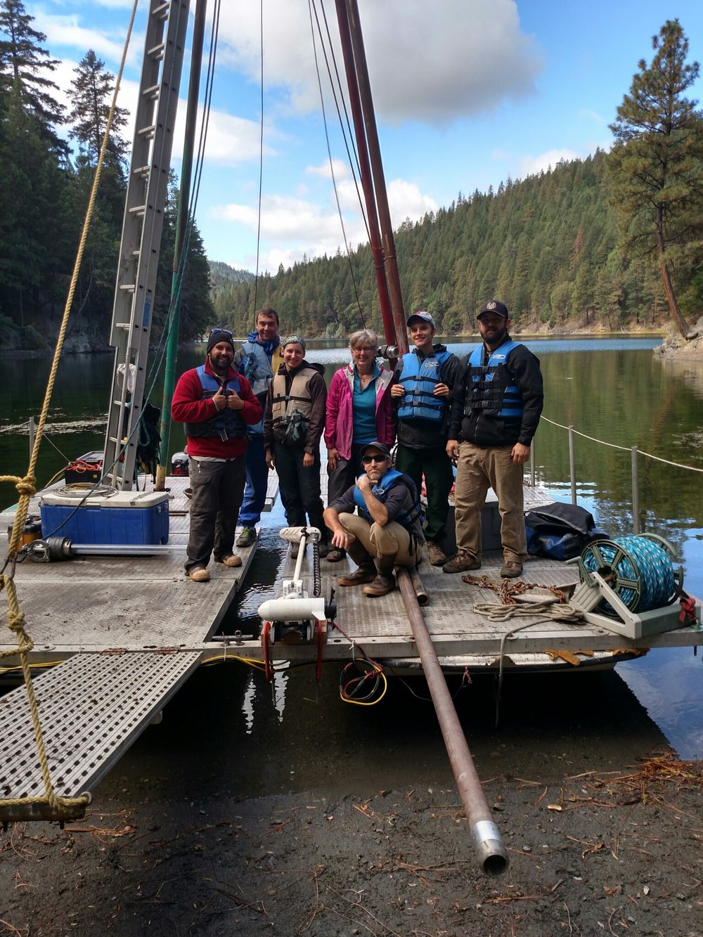 2015 field crew posing on the Kullenberg coring platform (Lower Squaw Lake, OR).