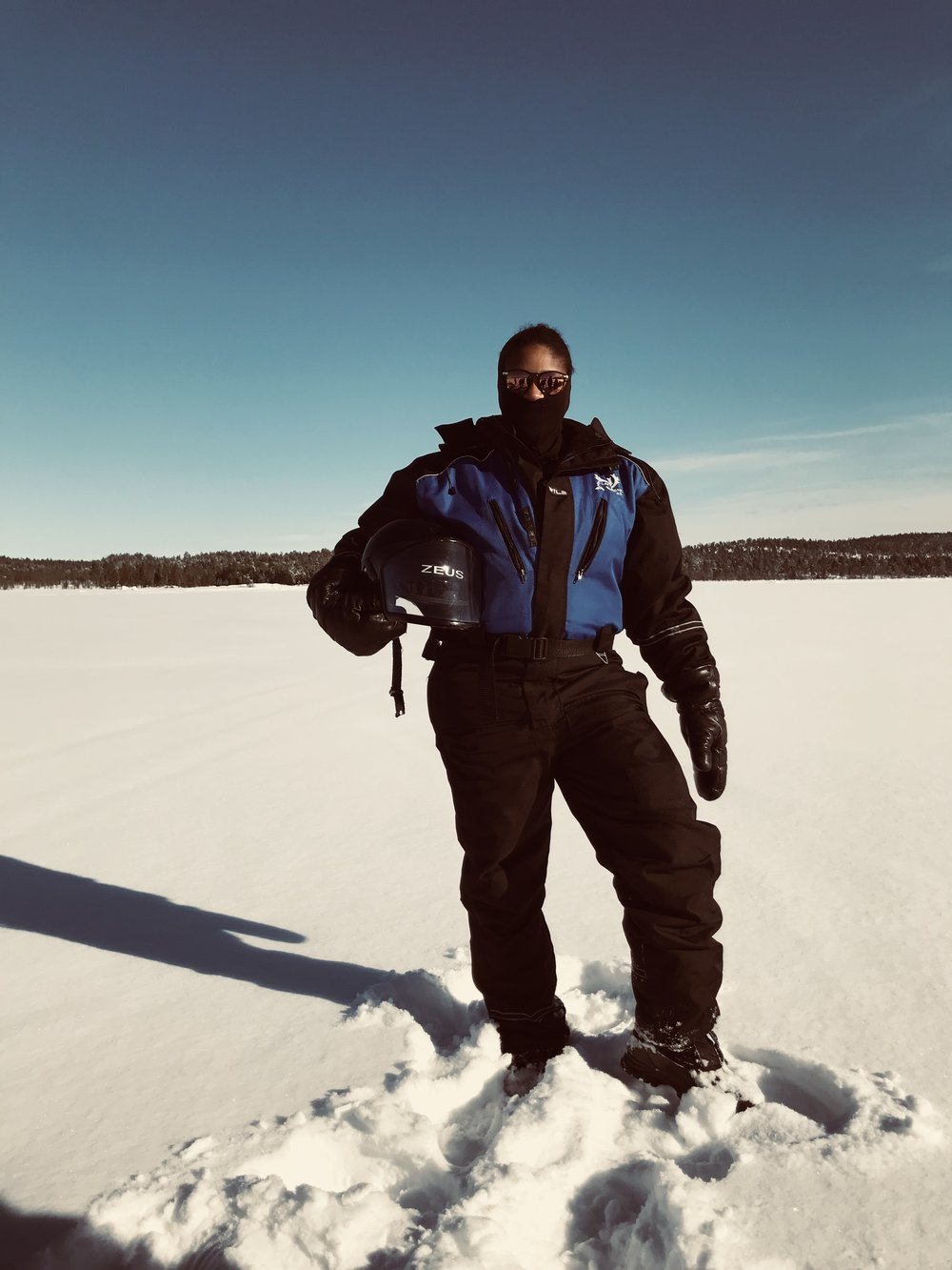 What to Do In The Arctic Circle of Finland - kakslaurrenanen Arctic Resort - Snowmobile - RachelTravels.com