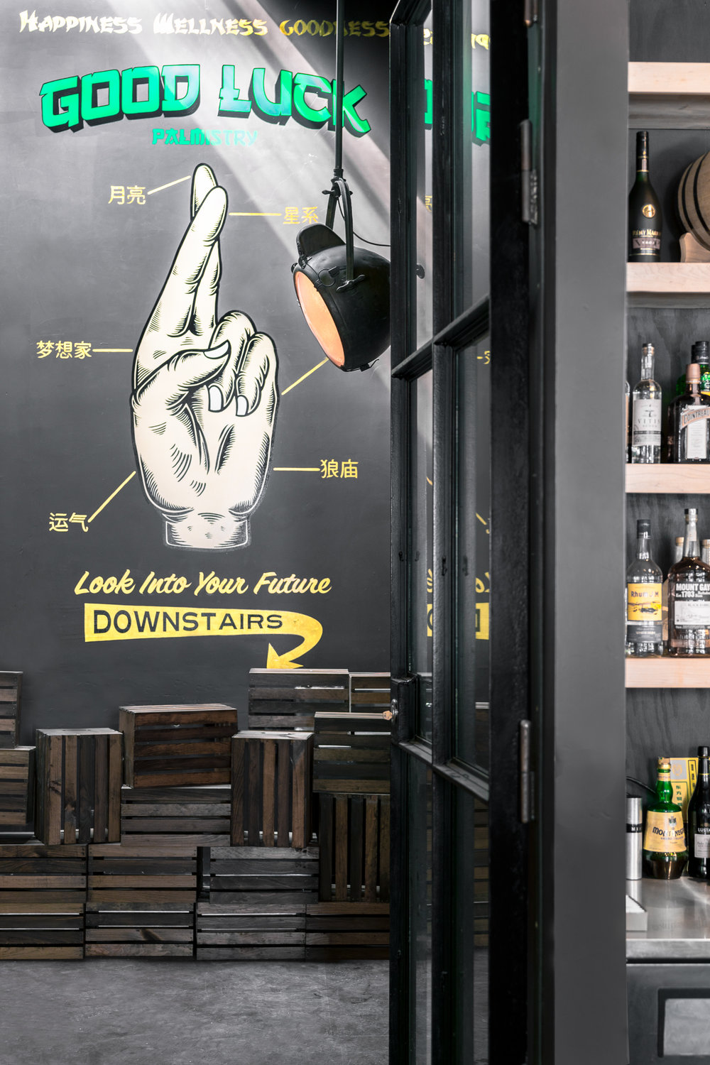 - Electric Coffin created a faux time-worn wheat paste wall of posters, two larger-than life paintings, a spinning zodiac wheel, custom bar/bench screen prints, and a whimsical palmistry mural.