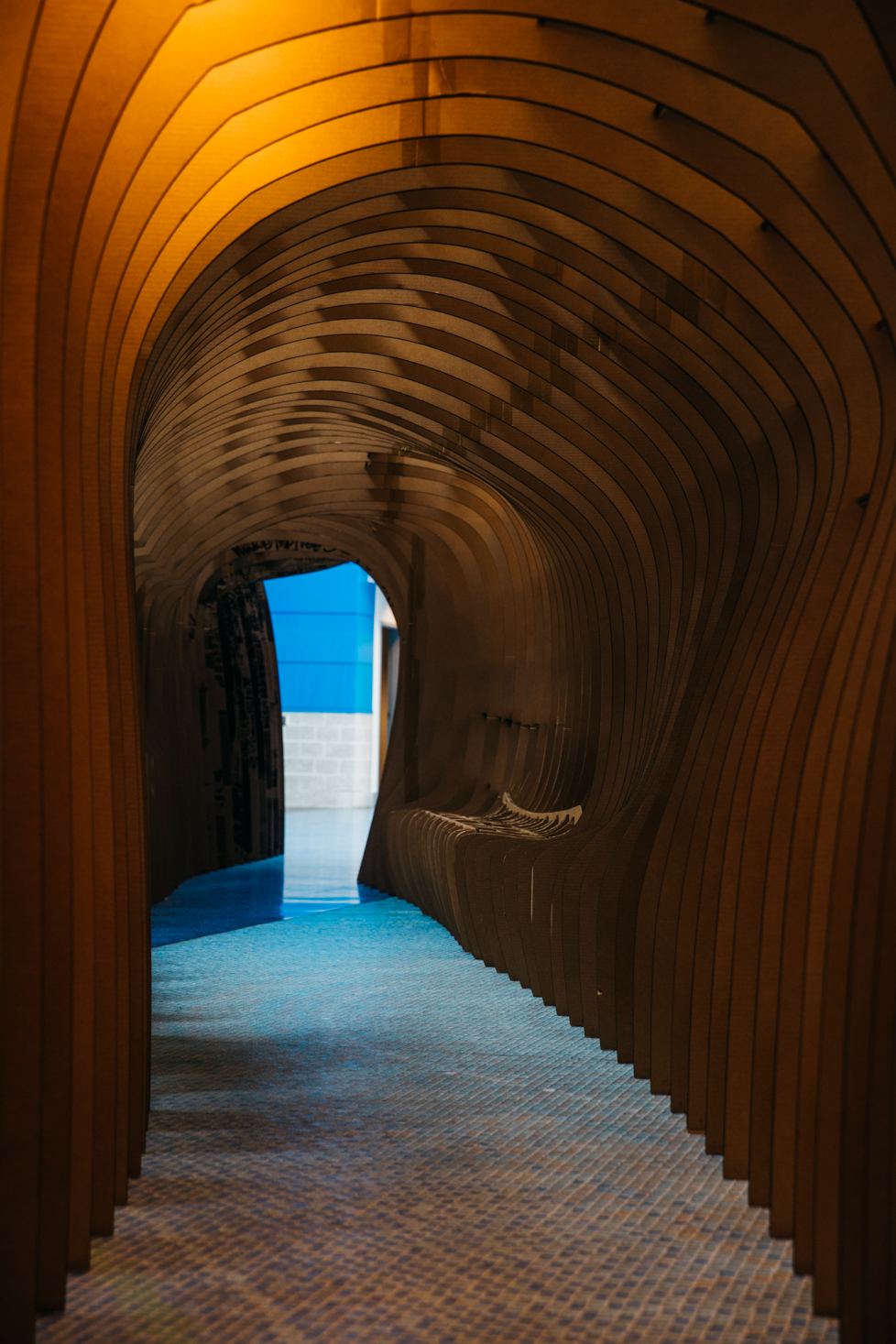 - The installation was free standing and constructed with no tools or glue. Custom, laser-cut cardboard fasteners brought the mass to life; it grew to 12 ft. in height including a walkway, window, and interior bench.