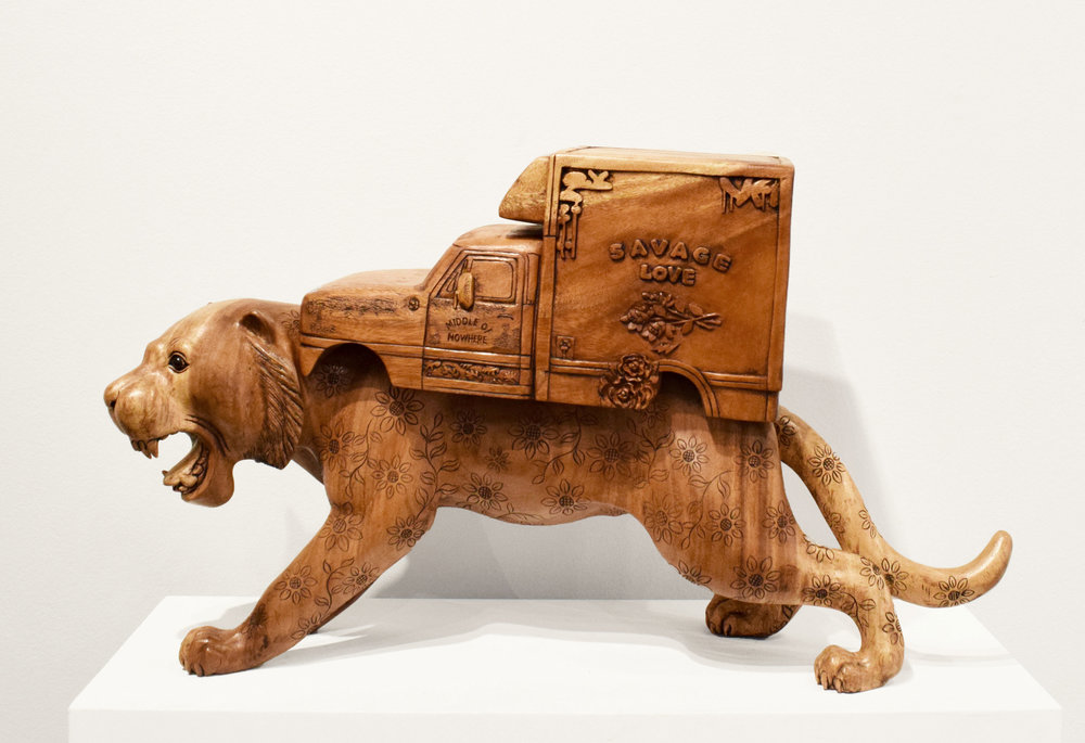 Carved wood, raging whimsy.