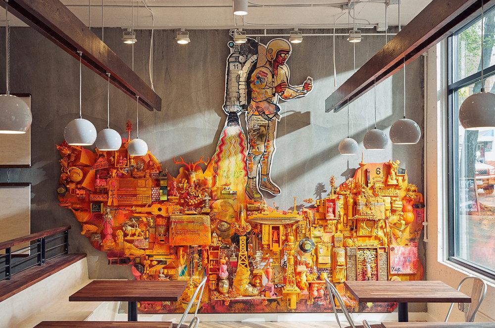 Cultural detritus, ply, acrylic paint, rocket fuel.