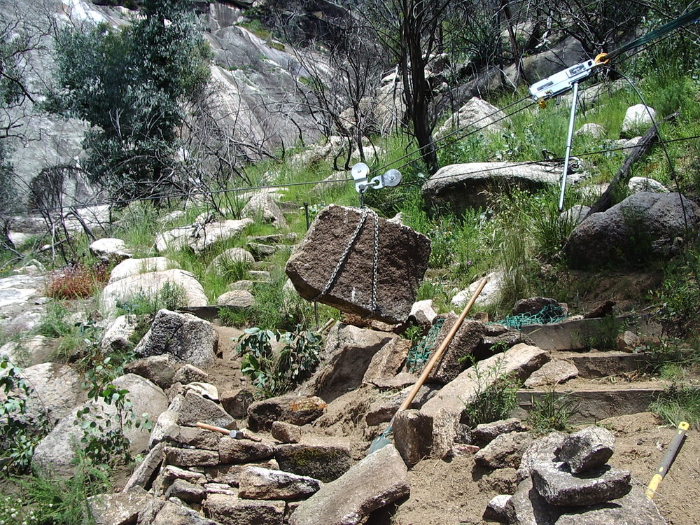 Winching rocks to site