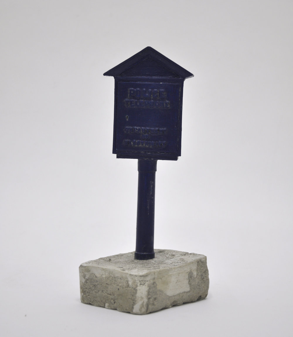 Malcolm Kenter, Police Box Mini, 2019, Enamel on Plastic, Cement, Wood, 3.5 x 3 x 8.5 in