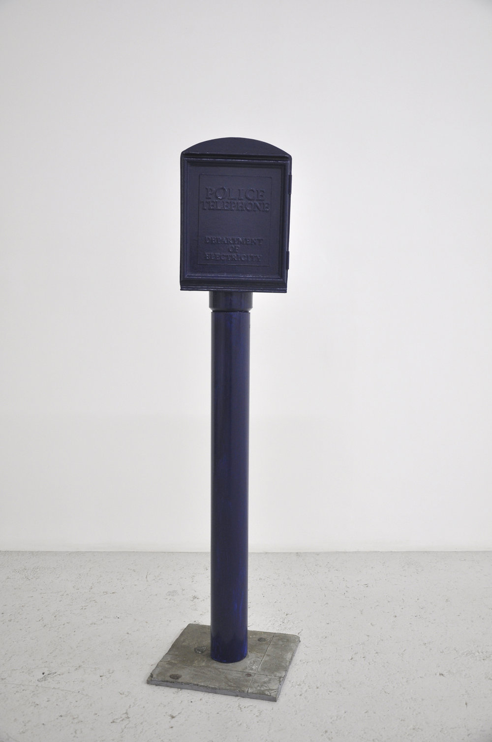 Malcolm Kenter, Police Box 1, 2019, Enamel on Wood, Foam, Plastic, Cement, Chewing Gum, 61 x 15 x 15in