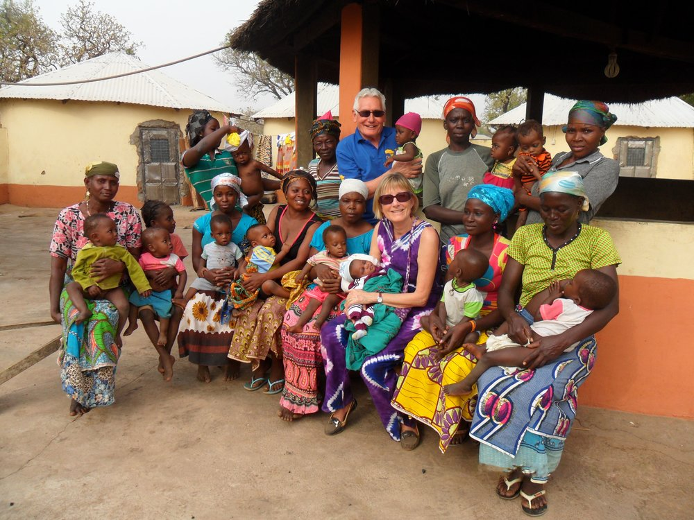 terry-and-ann-with-nutrition-centre-ladies-and-babies-min.jpg
