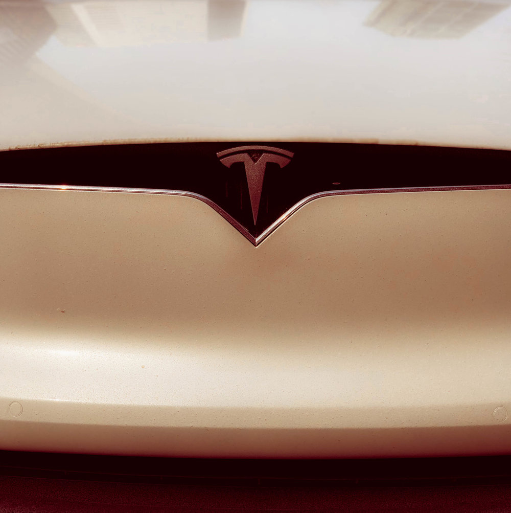 Tesla slashes electric car prices for US customers -