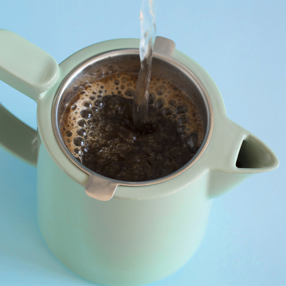 Pour over the water, making sure all the ground coffee is covered by the water -