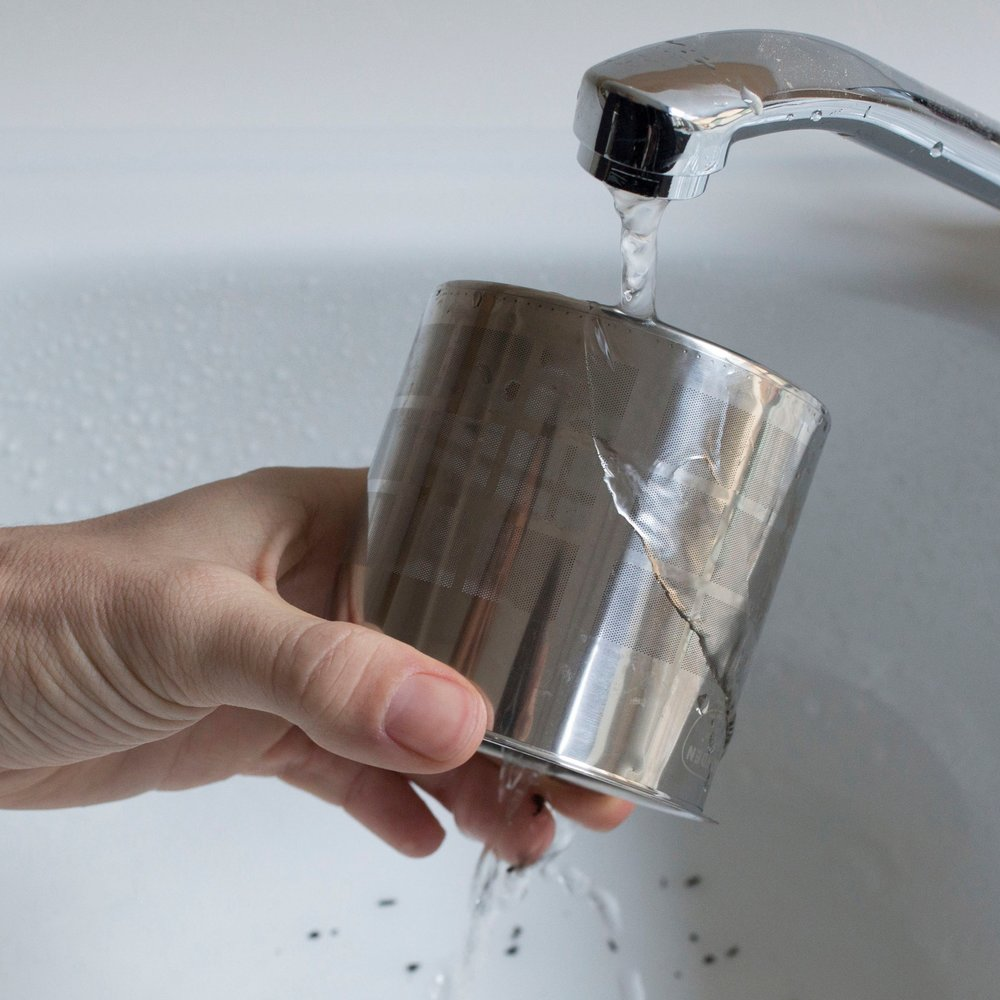 Rinse the filter under warm water and dry -