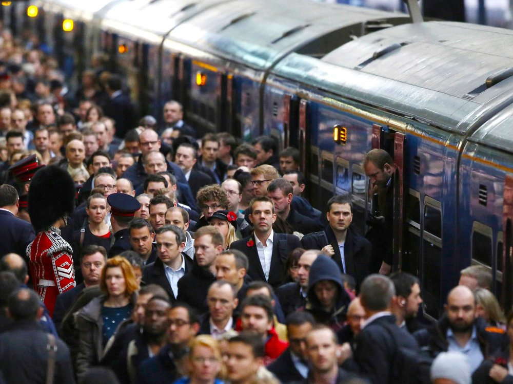 Commuters disembarking at Kings Cross at rush hour - image from Business Insider