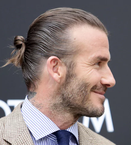 Beckham's receding hairline is noticeable with longer hairstyles