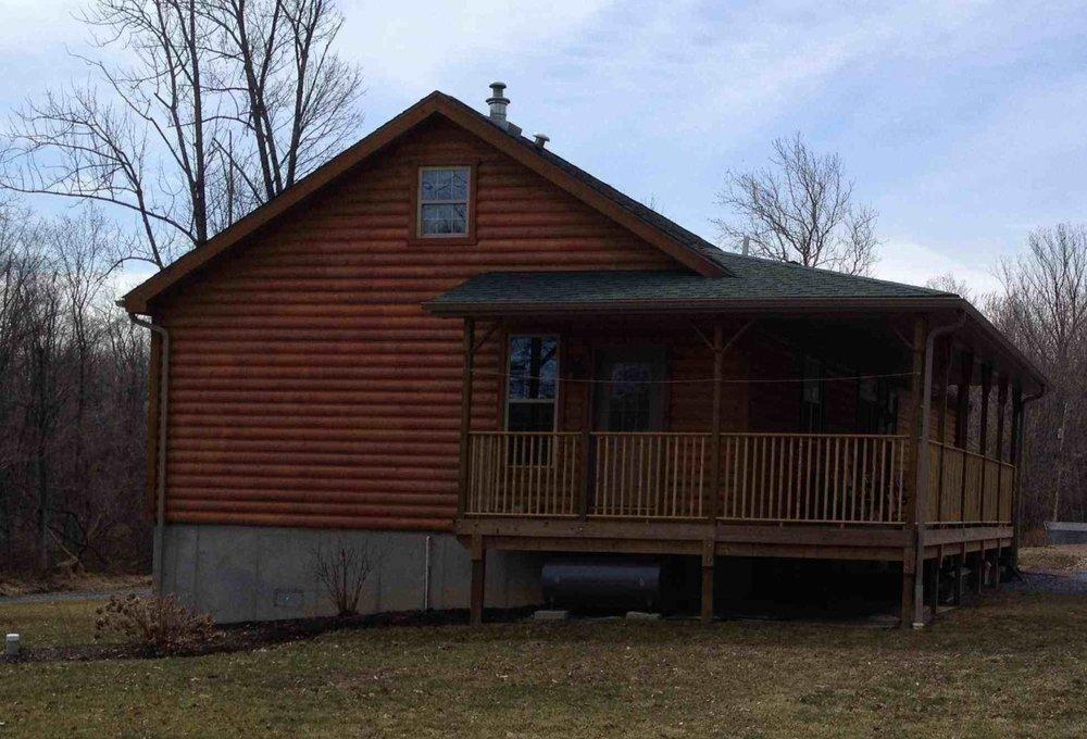 boltz log home rear porch.jpg