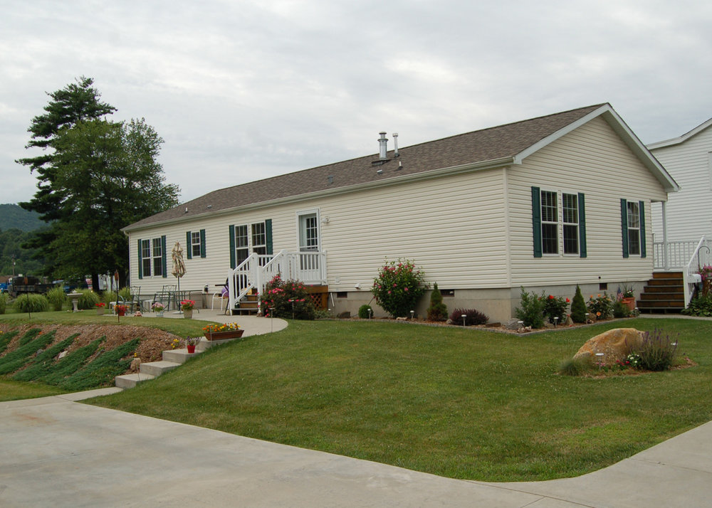 Manufactured Home on Concrete Foundation, Pressure Treated Decks with Vinyl Railing, and optional 5/12 Roof Pitch.