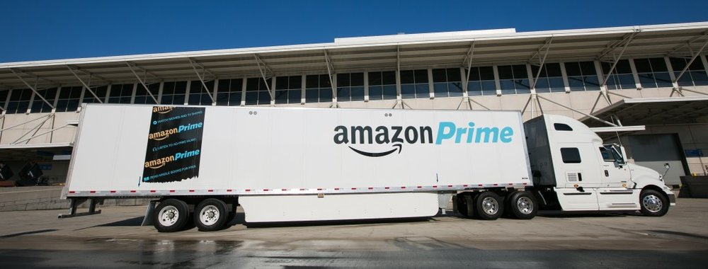 """At an event today in Chicago, Amazon employees from nearby fulfillment centers packed 2,000 care packages to send to soldiers abroad who are not able to come home for the holidays Friday, December 4, 2015. Since 2010, Amazon has shipped more than 12 million packages to APO and FPO addresses. The Amazon care packages for the troops included holiday chocolates and snacks alongside an Amazon Fire tablet. The care packages for soldiers headed off in an Amazon branded trailer—one of thousands that Amazon has started to roll-out to increase capacity in the supply chain. Amazon's Vice President of North America Operations Mike Roth said, """"I couldn't be more pleased that our very first Amazon trailer headed out on the road carrying such special packages—thousands of boxes filled with beloved holiday items and Amazon Fire devices to support troops abroad this holiday season. (Photo by Peter Wynn Thompson/AP Images for Amazon)"""