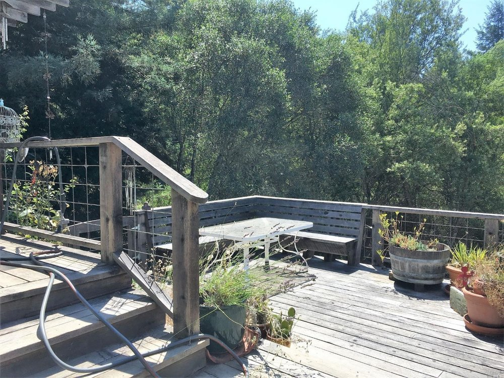 Outdoor dining deck on a home for sale on Guntly Road in Philo, CA.