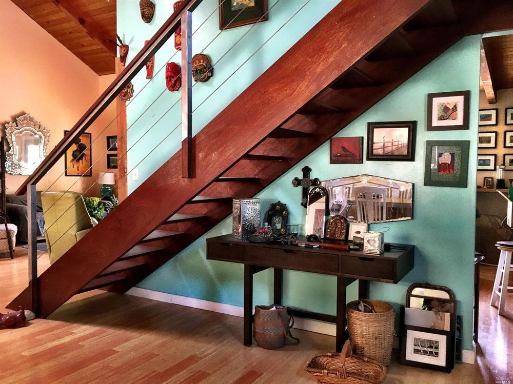 Beautiful redwood staircase in a home for sale on Guntly Road in Philo, CA.