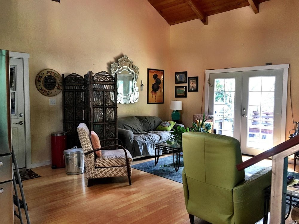 High ceilings in a living room in a home for sale on Guntly Road in Philo, CA.